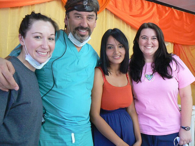 Dr. Villalobos taking a picture with three women