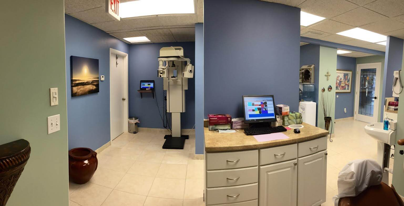 picture of the office showing the digital scanning machine and an examination room